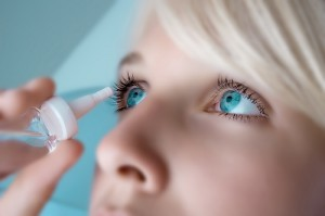 woman-preventing-dry-eyes-with-drops
